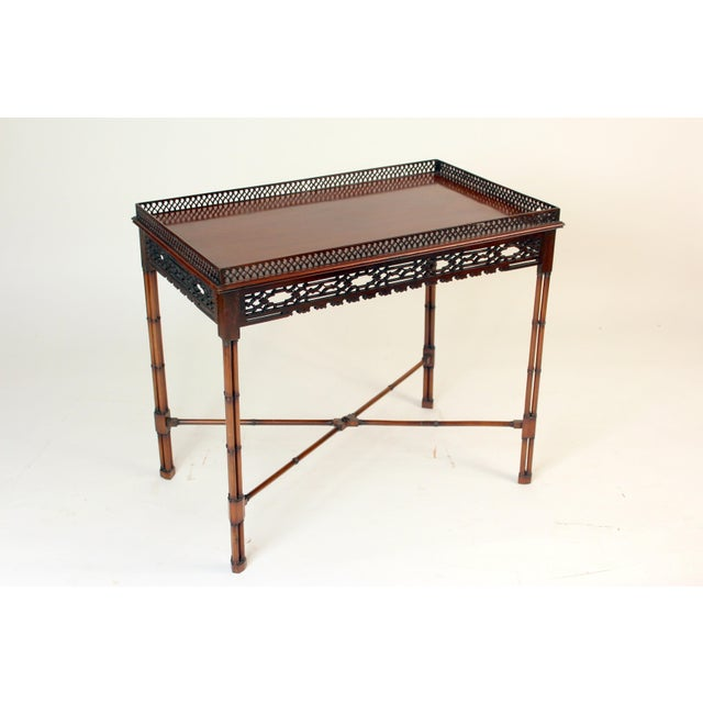 Chinese Chippendale style tea table, circa 1930-1950. Excellent fret carved gallery and apron. Bamboo style carved legs...