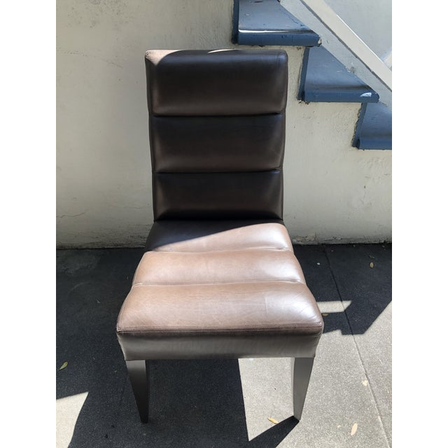 Ooma Side Chair by Dakota Jackson. Undulating back and seat in dark brown leather with solid cherry legs in satin brown...