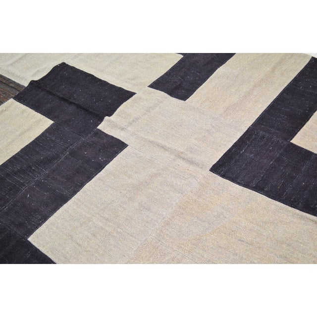 Vintage Afghan Modern hand woven kilim with natural colors and geometric pattern.