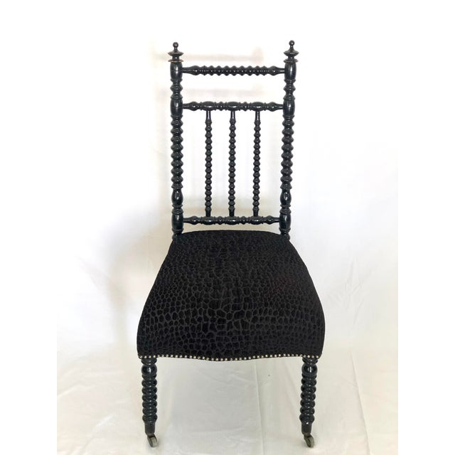 Antique French prayer chair newly reupholstered in a high/low velvet in an animal print pattern with nailhead trim and...