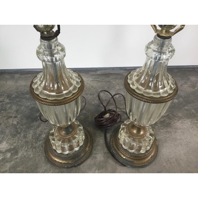 Beautiful pair of glass table lamps. They have very nice patina.