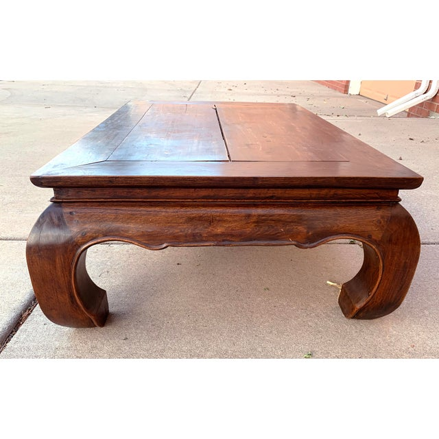 This handsome vintage coffee table is from Thailand and was made from teak wood in the 1980s. This coffee table features a...