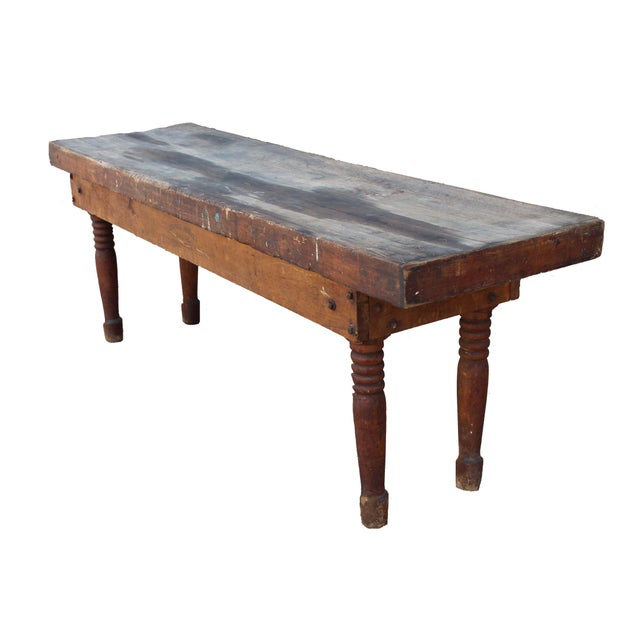 This is a fantastic antique, distressed farm table/console with beautiful turned legs and the original manufacturers...