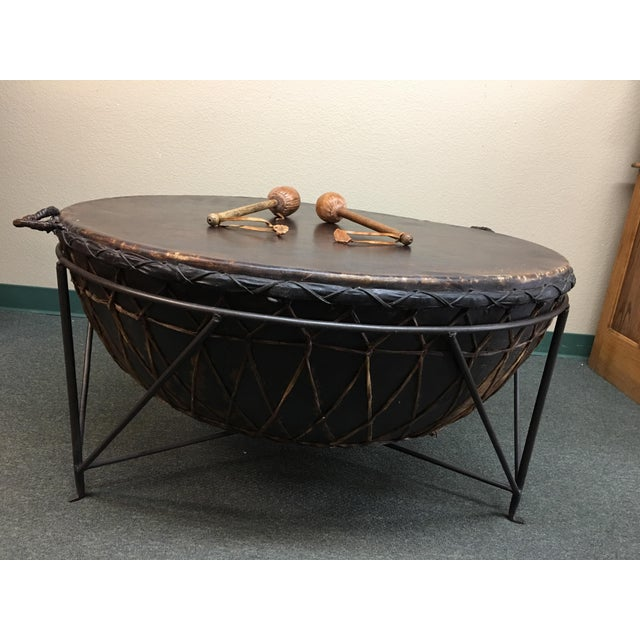 Design Plus Consignment Gallery presents a unique centerpiece for home or office. An exotic African drum is suspended on a...
