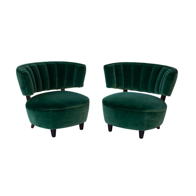 Pair of channel back slipper chairs in the style of Billy Haines or Grosfeld House. The hardwood frames have been newly...