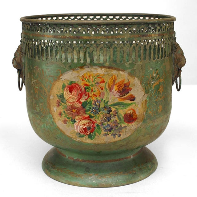 Pair of French Victorian green tole cachepots with floral design and filigree top.