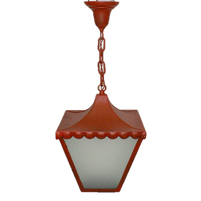 C. 1905 Regency style cast and sheet iron hanging lantern having red patination and frosted glass panels. Rewired and...