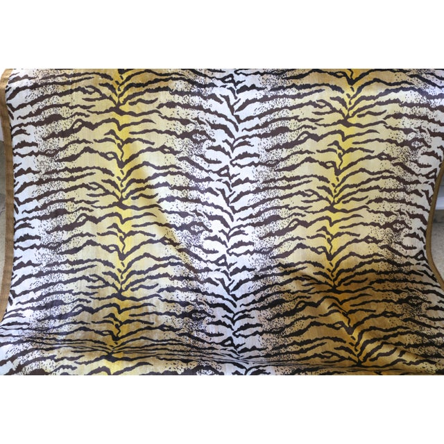 Velvet fabric in Tiger Striped pattern. Fabric is 54 inches wide. Selling 1 yard length of this fabric.