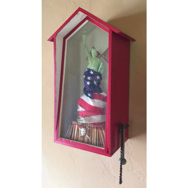 A vintage mixed media sculpture from 1989 signed Mew. A fun pop political piece with Statue of Liberty atop a pile of...