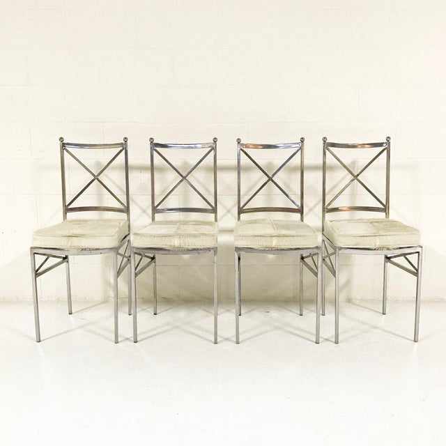 We love the lines of these mid-century Swedish dining chairs. The gleaming polished steel is softened by the texture of...