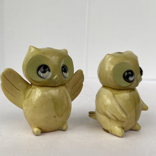 Here are a pair of very expressive celluloid owls. They are cutie pies. Smaller Owl measures: 1.25 W 1.75D and 2 in high.