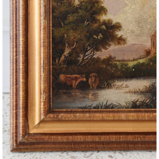 Charming circa 1830s antique English oil painting on artist board of a castle and cattle drinking from a river. Unsigned...