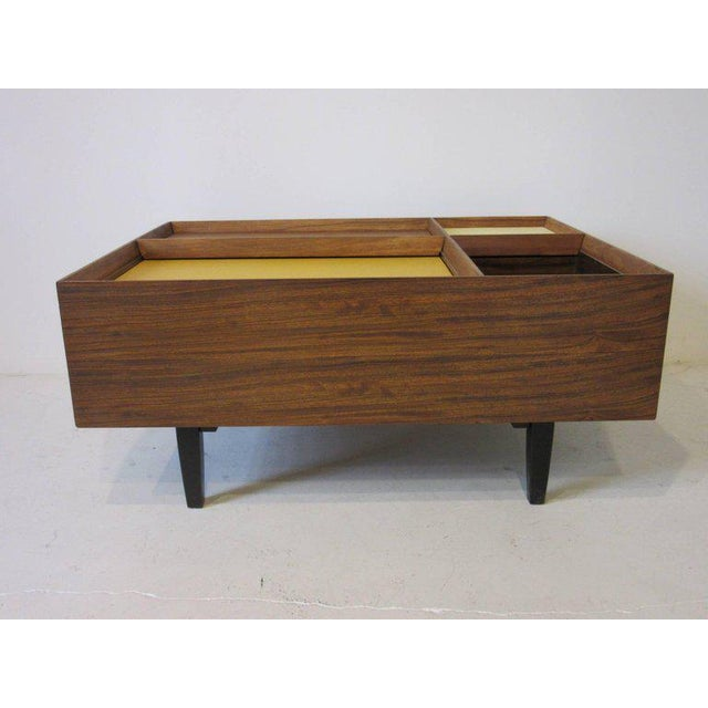 A very early coffee table by Milo Baughman using exotic Mindoro wood from the Philippines which is know for it's beautiful...