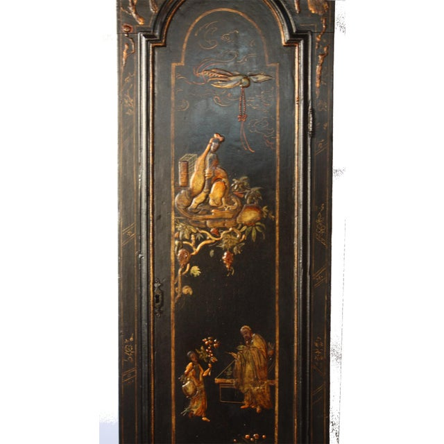 A George II longcase clock with chinoiserie decoration by London clock and watchmaker John Crouch / Knightsbridge (an...