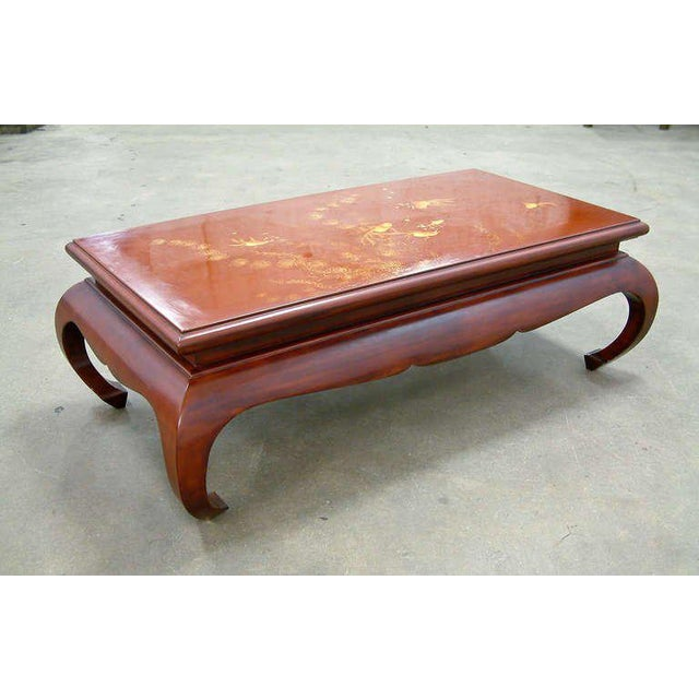 Viet Nam 1972 A beautiful cinnabar lacquered coffee table in the Asian style with an updated stylized base of mortise and...