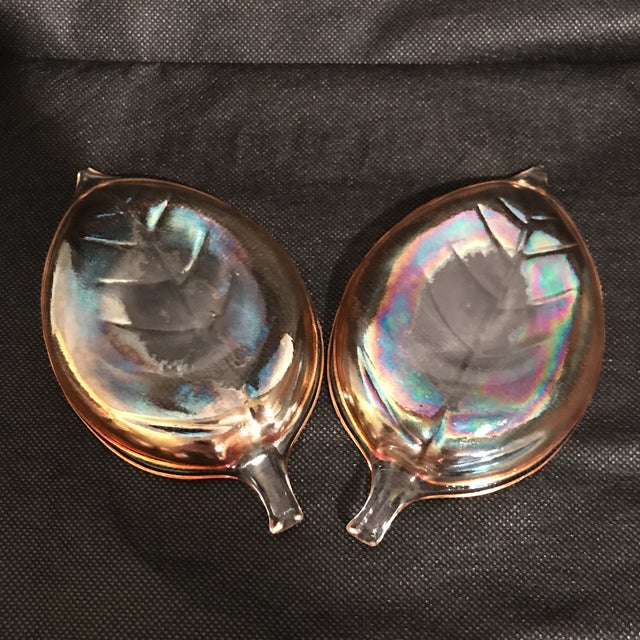 Pair of iridescent amber carnival glass leaf plates or dishes.