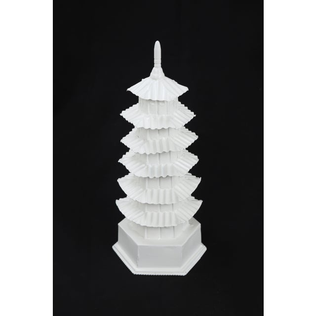 "This white painted tole pagoda has 6 levels with a glossy finish. Each ""panel"" is seemingly decorated with a cosmetic..."