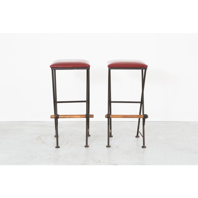 A set of stools designed by Cleo Baldon in the USA, c 1960s. These are reupholstered in full grain oxblood red leather and...