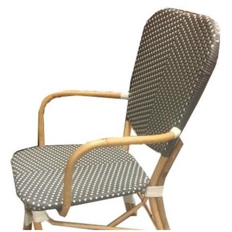 Piazza rattan and synthetic Parisian bistro-style woven armchair from Indonesia. 22 inches wide, 24 inches deep, 35 inches...