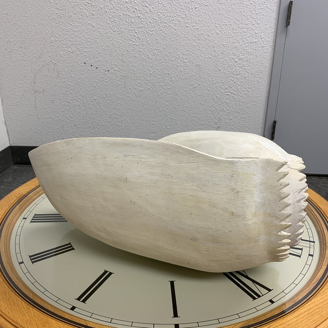 Design Plus Gallery presents a Large Mid-20th Century Carved Wood White Conch Shell. Meticulously carved and painted to...