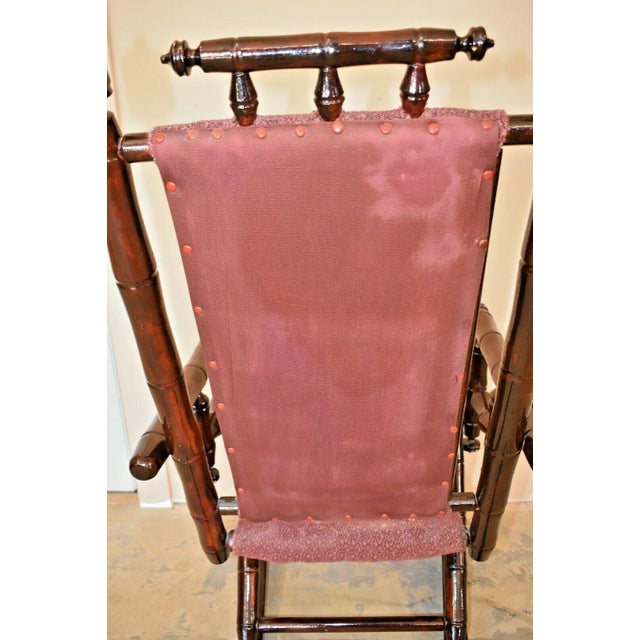Wood Vintage Faux Bamboo Rocking Chair With Mahogany Finish and Maroon Upholstery For Sale - Image 7 of 10