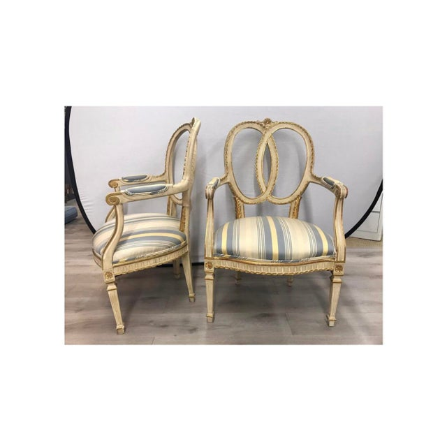 Elegant pair of French cream painted armchairs with cotton fabric.