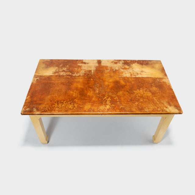 This artisan made table with hoofed feet from Canton is hand-carved of reclaimed elm wood. Its top is covered in a select...