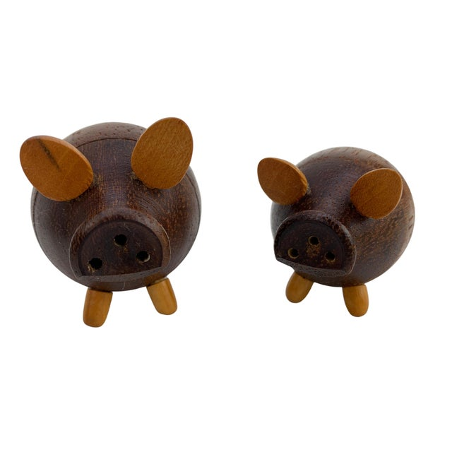 Adorable handmade and hand carved salt & pepper shakers in the shape of a pig on a small walnut tray. Salt is larger than...