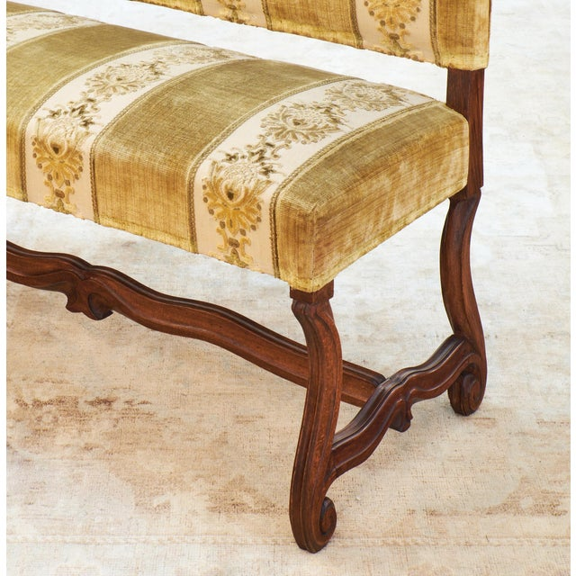 Circa 1880, antique French hand-carved walnut frame bench with all original Genoa silk velvet fabric in green and gold. A...