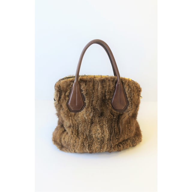 A beautiful handbag from Italian luxury brand Tod's. This authentic Tod's handbag is designed with rich brown mink, supple...