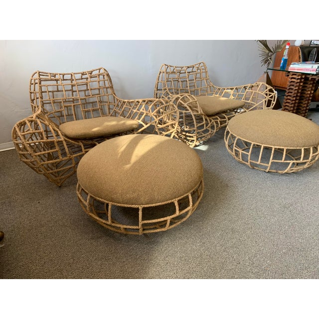 Gorgeous pair of low seated club chairs & ottomans. Each chair features a wide and low seated body of marine rope over...