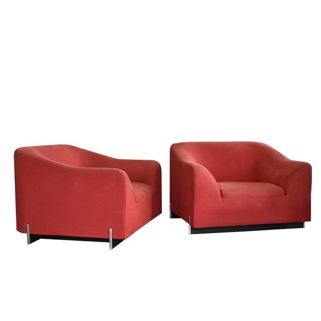 Pair of two Ligne Roset armchairs in red. This beautiful pair of modern armchairs are a wonderful way to add a bright pop...