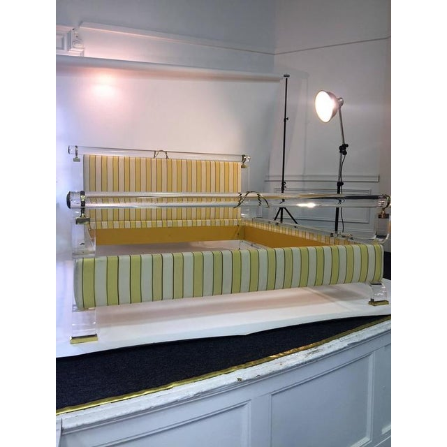 Great modern 1970s design Lucite and brass bed frame with high end custom yellow, gold and white striped fabric...