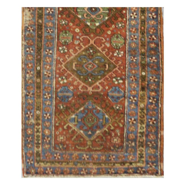 This beautiful rug is hand made, made in Iran. It features a pattern in a vibrant combination of pink salmon, green, blue,...