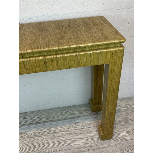 Karl Springer style grass cloth wrapped console table. Great condition.