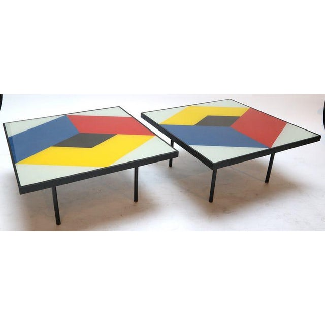 Pair of reverse painted glass coffee tables with colorful, geometric design. T-326
