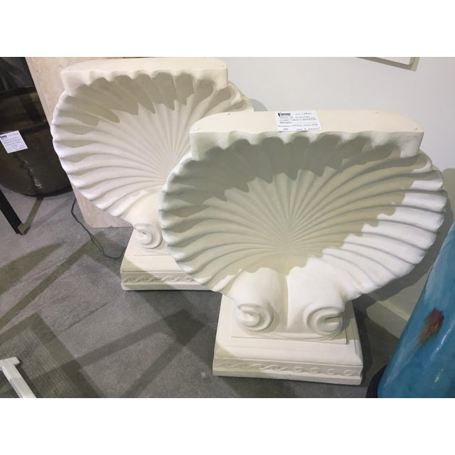 This stylish pair of shell console table bases could be also used as a dining table base. The pieces are cast plaster with...