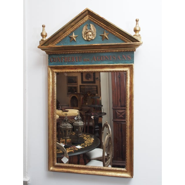 A 19c frame now used for a mirror, the frame originally in a church and housing a list of names of the members of the...