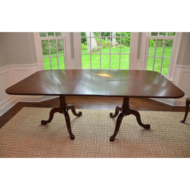 Henkel Harris Queen Anne style dining table features a double pedestal, class styling and quality construction. Made of...