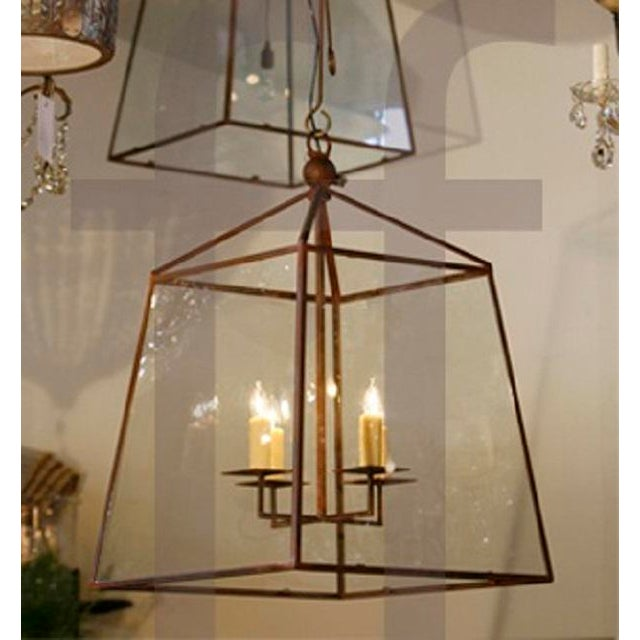 This timeless, large-scale, iron lantern is blacksmith made with tempered glass. It comes with a handmade canopy and three...