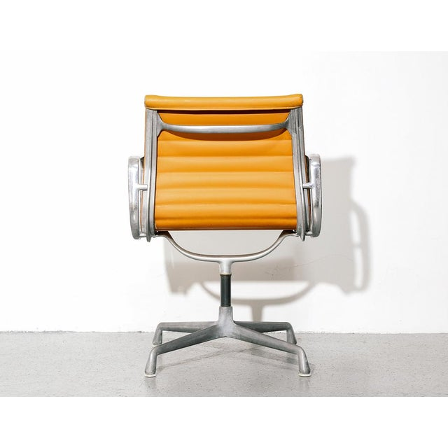 Vintage Eames Aluminum Group Chair in Orange For Sale - Image 10 of 11