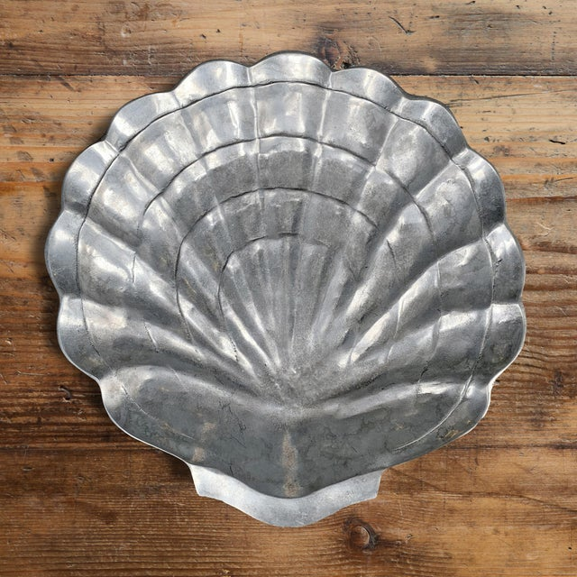 A rather large aluminum clam shell bowl, more than likely originally used for holding ice and serving oysters. It's...