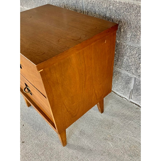 Wonderful vintage nightstand. Made in the 1960's. Features two drawers. Perfect to use as a nightstand or side table. This...