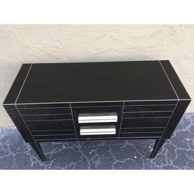 About Beautiful and elegant black mirrored commode. Spectacular white glass handle. Two-brake drawers. Oakwood furniture...