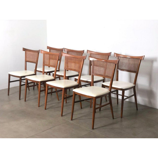 Set of 10 Paul McCobb bowtie dining chairs for Winchendon. Made in the USA circa 1950's. Solid maple frames with cane back...