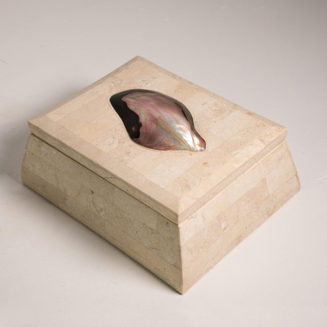 This is a vintage Maitland-Smith handmade tessellated box with a shell detail. The piece features a light stone paved...