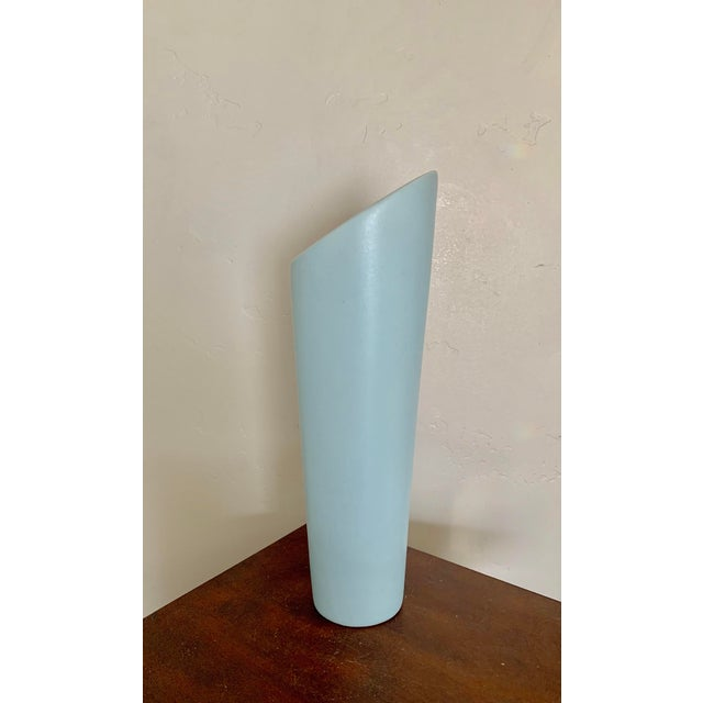 Modern asymmetric ceramic vase with light blue glaze. Tall and sleek, this vase makes a great addition to any modern or...