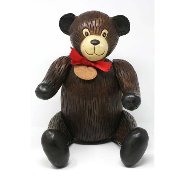 "A handmade, carved wood teddy bear, with moveable arms, legs and head. Excellent condition. 12 1/4"" x 10"" x 10 1/2""..."