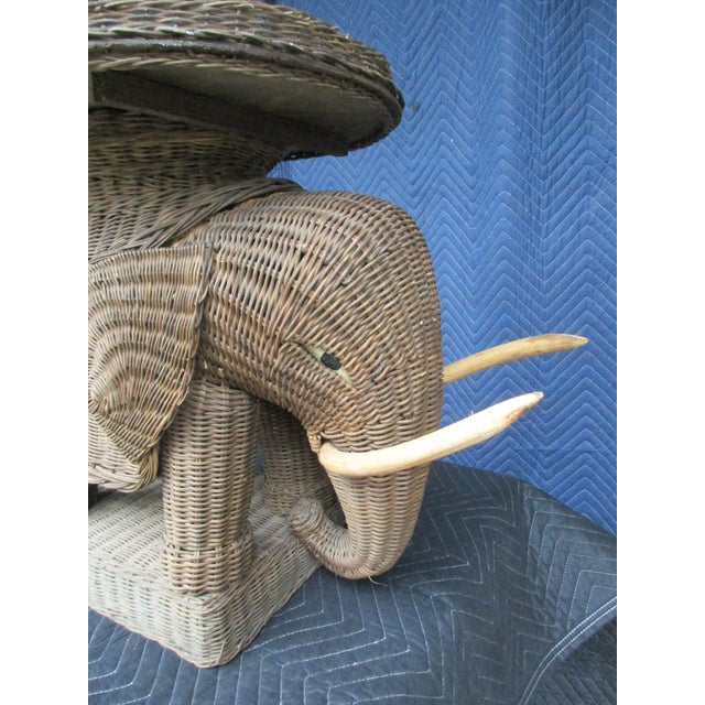 This wicker elephant side table has a removable tray on top. It's a great decorative piece but not recommended for actual...