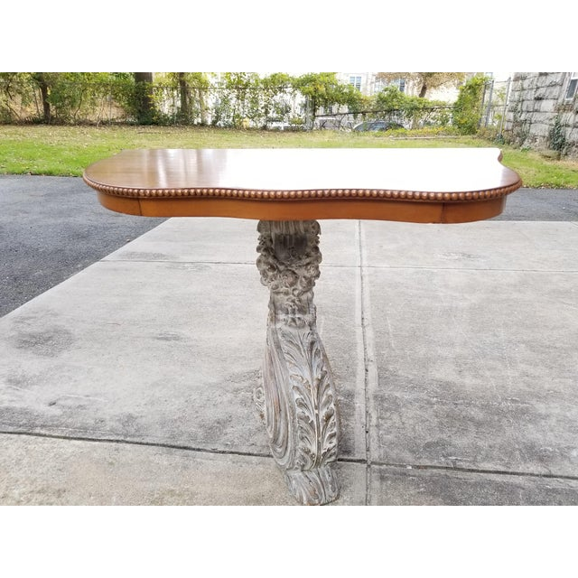 Stunning antique French solid carved wood scroll leg form console table with mahagony table top. The single leg has a very...